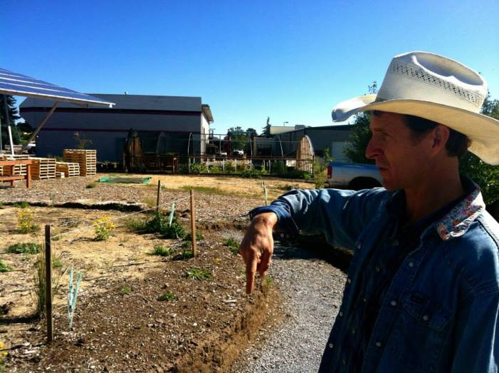 Jonathon Taylor, the permaculture teacher, sharing plans for the students next project.